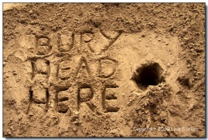 SAND bury head here