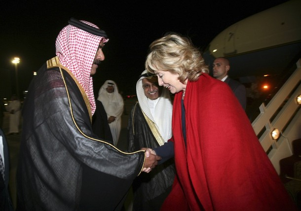 U.S. Secretary of State Hillary Clinton is greeted by a Saudi official upon her arrival at King Khaled airport in Jeddah
