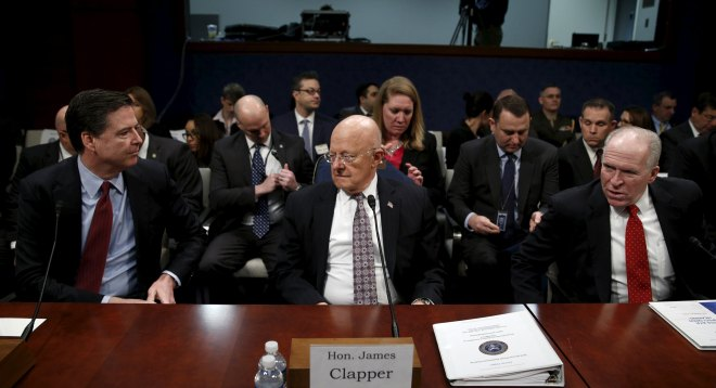 """FBI Director James Comey, U.S. Director of National Intelligence James Clapper and CIA Director John Brennan take their seats to testify in a House Appropriations hearing on """"World Wide Threats"""" on Capitol Hill in Washington"""